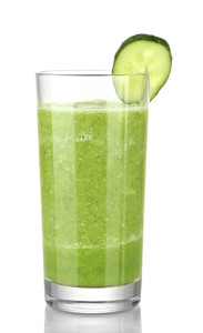 Green vegetable juice isolated on white